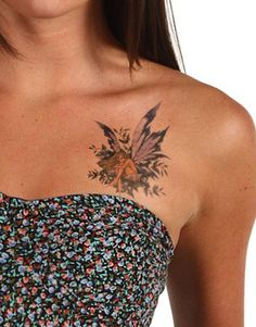 or a butterfly tattoo on my chest..not thsi tattoo, though..this one's ugly. i just want a simple butterfly.