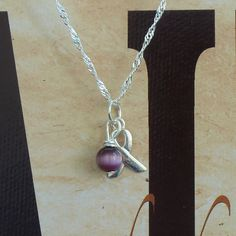 chronic pain jewelry: Fibromyalgia Dravet by ShadesofAwareness. $28.95, via Etsy.
