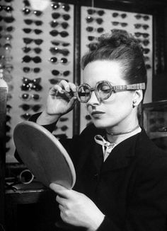 Maeve Brennan trying on wooden framed glasses photo by Nina Leen for LIFE Magazine, 1945 // edith's head