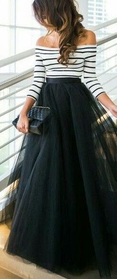 Long black tulle skirt with black and white striped, off the shoulder knit shirt.