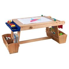 Let's get creative! Our Art Table with Storage gives budding artists everything they need to create their next masterpiece. Young boys and girls who already like using easels will love getting to draw, paint and color.