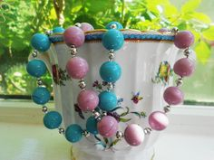 Unusual opaque Murano glass beads in clear blue and pretty pink with sterling silver beads and clasp. http://dianaingram.homestead.com/Index.html