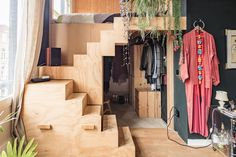 DIY loft bed with clothing storage underneath in a boho apartment in Amsterdam