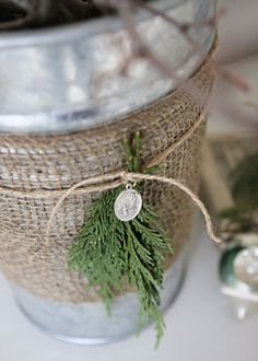 """burlap ribbon and twine around silver pail (add starfish or shell)- fill with goodies for """"welcome bag"""""""