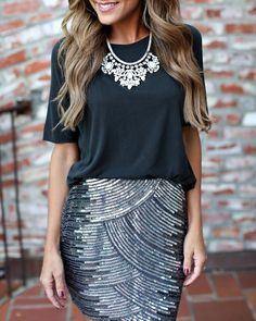 Pair a sequin mini skirt with a basic silk blouse for a casual glam feel.