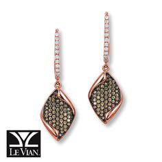 Leaf-shaped dangles embellished with decadent Chocolate Diamonds® accented in black rhodium sway from hoops adorned with sparkling Vanilla Diamonds® in these exquisite earrings from Le Vian®. Fashioned in 14K Strawberry Gold®, the earrings have a totals diamond weight of 1/2 carat, and secure with hinged backs. Le Vian®. Discover the Legend. Diamond Total Carat Weight may range from .45 - .57 carats.