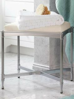 Our Belmont Vanity Stool brings polished sophistication to the master bath.