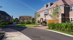 A street view of a set of family homes by Nicholas King Homes. Family Homes, Home And Family, Kings Home, Street View, Mansions, House Styles, Gallery, Image, Home Decor