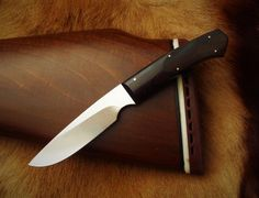 Lightweight hunting and utility knife by South African knife maker Louis Naude also known as LEO knives and cutlery. The knife on the picture is called the Buteo and it has an African Blackwood handle. It is available from Louis Naude knives (LEO Knives). Just waiting for your choice of handle material that includes a selection of African hardwoods, synthetic materials and animal products like scorched Giraffe bone.  Louis Naude knives ships worldwide.