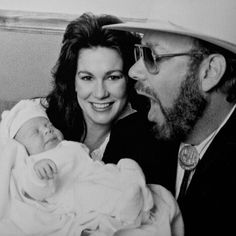 Hank and his wife, Mary Jane Thomas with baby Katie