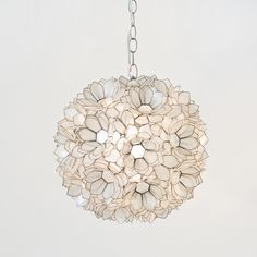 "Capiz Lotus Pendant by Worlds Away.  Contains one socket UL approved for 60 watt bulb. Comes with 36"" length of silver chain and canopy. Available in small or large."