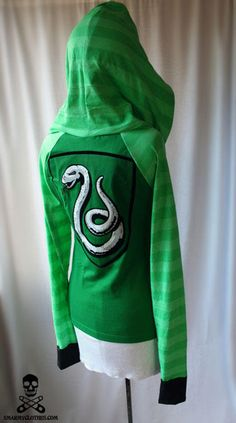 awesome slytherin hoodie!! wish i had one for ravenclaw <3 and hufflepuff... and gryffindor.. while im at it why dont i get all of them and a black hogwarts one :D a girl can dream