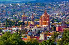Panoramic view of San Miguel de Allende, Guanajuato, Mexico . towering above the town is the Parroquia de San Miguel Arcángel Monuments, Visit Mexico, Cabo San Lucas, Mexico Travel, Travel And Leisure, Best Cities, Mexico City, Real Mexico, World Heritage Sites