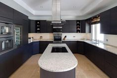 semi-circle kitchen and island in middle... love!