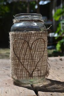 Mason Jar (really a pasta sauce jar!) wrapped in burlap & decorated with a twine heart, make beautiful vases, candle holders, etc.