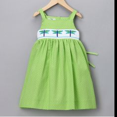 Beautiful dragon fly smocking on a lime green dress!