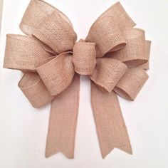 Best 11 This bow is created with 5 wide wired burlap ribbon. Great for the wreaths, swags, garlands and more. This bow is 12 wide, streamers are 11 long. If you are looking for a custom bow we will work together with you to create the perfect bow, I will Diy Bow, Diy Ribbon, Ribbon Flower, Fabric Flowers, Diy Wreath, Burlap Wreath, Wreath Bows, Make A Wreath Bow, Burlap Bow Tutorial
