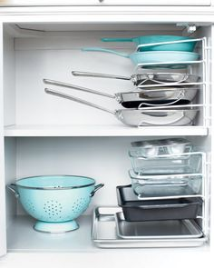 You can remove one pan without having to remove them all. Turn a vertical bakeware organizer on its end and secure it to the cabinet wall with cable clips. I need to do this!