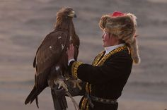 The first falconress of Mongolia: Incredible pictures of a teenage girl and her golden eagle