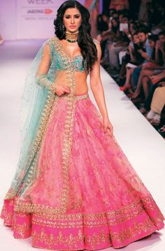Nargis Fakhri walked the ramp for Anushree Reddy in a pink-printed net lehenga, green choli and tulle dupatta on Day 5 at the Lakme Fashion Week Winter/Festive 2014.