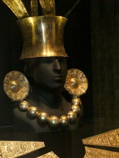 Inca ceremonial jewelry and headdress on display at the Larco Archaeological Museum in Lima, Peru