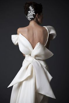 We love the sculptural bow on the back of this fashion-forward satin gown from Krikor Jabotian's newly unveiled Amal collection.