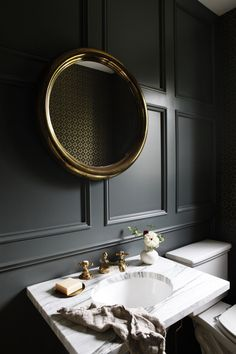 Dramatic dark green walls + millwork + wainscoting + quartz countertop | Katie Hackworth