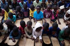 Pupils attend a Koranic school in the town of Small Sefoda in eastern Sierra Leone, April 22, 2012.