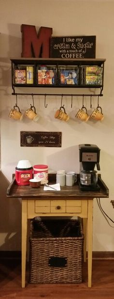 So in love with my coffee bar... hobby lobby shelf with decor and refurbished sewing machine