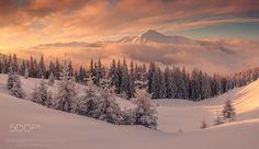 Fantastic orange evening landscape glowing by sunlight. Kukul ridge, Carpathians, Ukraine, Europe. Merry Christmas!