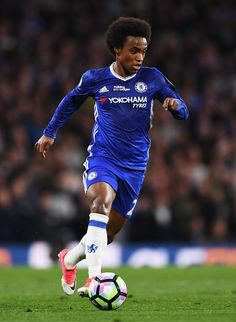 Willian of Chelsea in action during the Premier League match between Chelsea and Watford at Stamford Bridge on May 15, 2017 in London, England.