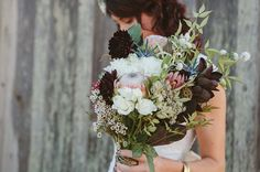 Handmade berry + protea bouquet