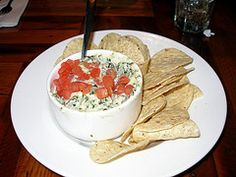 Olive Garden's Hot Artichoke-Spinach Dip.  Make exactly as stated, but half the red pepper flakes and it's still kinda spicy (just warning you!)