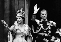 The Queen wearing the Imperial State Crown and The Duke of Edinburgh in the uniform of Admiral of the Fleet wave to crowds from the balcony of Buckingham Palace following the Coronation on 2 June 1953.