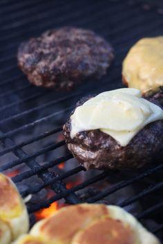 cheesy yummy cheddar burgers on the grill.