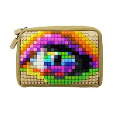"""Your clutch may have been expensive, but it's also a little bland. (Not the contents—we know those are NSFW—more the exterior.) Give your purse a party with the Canvas Clutch. This creative carrier features a studded silicone back that can be decorated in a million ways with the included """"pixels."""" Totally unique in look, the case offers four internal sleeves for organization."""