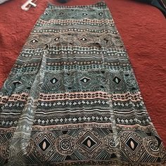 Maxi skirt Kendall and Kylie maxi skirt tribal print never worn has two front slits. Kendall & Kylie Skirts Maxi