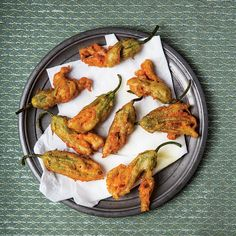 Fried Anchovy-Stuffed Zucchini Blossoms from SAVEUR - Light and airy, with a subtle squash flavor, zucchini blossoms are wonderful to cook; they make a flavorful, delicate appetizer when stuffed with salty anchovies and fried. Fancy Appetizers, Italian Appetizers, Finger Food Appetizers, Finger Foods, Appetizer Recipes, Zucchini Flowers, Zucchini Blossoms, Stuffed Zucchini, Fried Zucchini