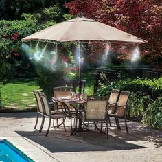 """A <a href=""""http://amzn.to/25wRGIO"""" target=""""_blank"""">misting system</a> that cools the surrounding area by up to 20 degrees."""