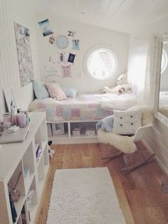 Cozy and calming girl's bedroom in soft shades of pink, blue, and beige.