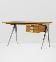 Jean Prouvé; Oak, Enameled Steel and Aluminum 'Compass' Desk by Ateliers Jean Prouvé, 1953.