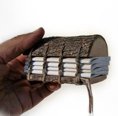 """Mini Rustic Natural Bark Bradford Pear Wood Address by tanjasova, $45.00. This mini journal is one of the rustics made from it. It has 122 Coptic hemp bound pages of acid free Strathmore artist paper. You may notice that the paper edge follows the natural branch edge. The size of the book is a little over 3"""" high, 3"""" wide and a bit over 2"""" thick."""