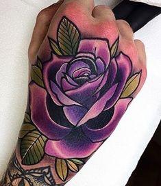 Purple flower hand tattoo