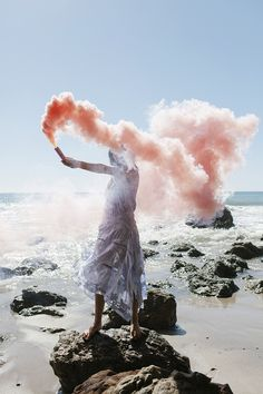 aimee song of style wears a self portrait dress and uses a smoke bomb