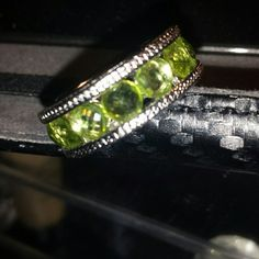 Peridot Eternity Band ring This sterling silver ring has peridot stones running all the way around the ring. Fits a size 5. Jewelry Rings