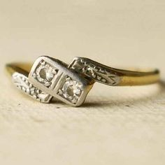 The way this oddly asymmetric ring holds two equal diamonds. | 40 Vintage Wedding Ring Details That Are Utterly To Die For