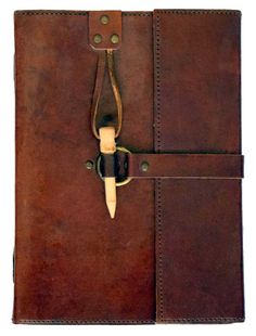 "A simple but handsome leather journal closed via a brass and strap secured in place with a wooden peg. Contains 120 pages of blank, handmade, linen parchment paper. 6"" x 8"""