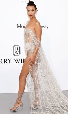 BELLA HADID After traveling to Rome with Bulgari, Bella returns to Cannes for the amfAR gala and clearly saves her sexiest gown for last in this sheer Ralph & Russo Couture design embroidered with crystals, glass beads and silver chain. Sexy Outfits, Sexy Dresses, Beautiful Dresses, Nice Dresses, Img Models, Bella Hadid Red Carpet, Style Bella Hadid, Sexy Gown, Lovely Legs