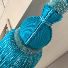Troynorth Northumbria Hexham Tieback in colour Butterfly, vibrant tones of Turquoise and pale blue.  Herringbone detail blending with soft ruche,  intricate stitching and natural full bodied tassel.