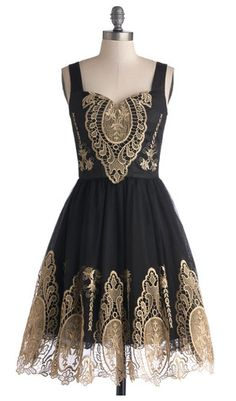 Dress, the oriental design on it reminds me of architecture, as the design looks like to represent architecture well. sweet silhouette